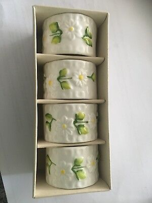 Boxed set of embossed china napkin rings