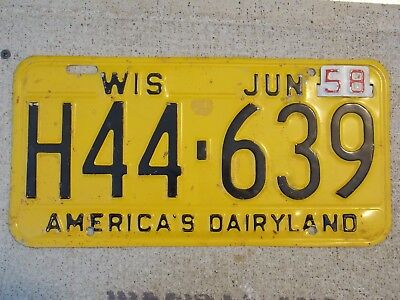 One 1957 Wisconsin America's Dairyland License Plate w/1958 tag ORIGINAL PAINT