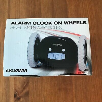 Sylvania Black Alarm Clock on Wheels SCR1300 with Batteries and Manual