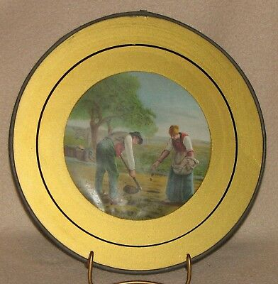 Antique Flue Cover showing a Young European Couple Planting Field