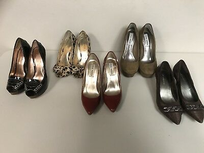A lot of 5 pairs of used size 6 womans shoes. Black pair is a size 5 1/2