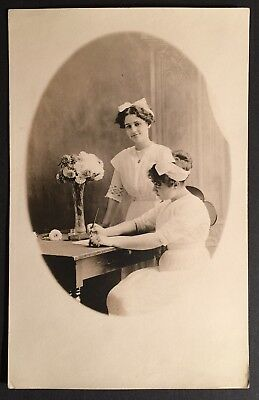 Real Photo Post Card NURSES IN UNIFORM 1920s AT TABLE / VASE OF FLOWERS