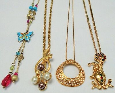 Four good vintage gold metal necklaces (enamel butterfly, pearl, paste clown)