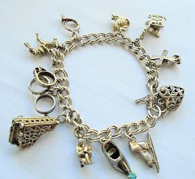 Good quality vintage solid sterling silver bracelet (inc padlock & 10 charms)