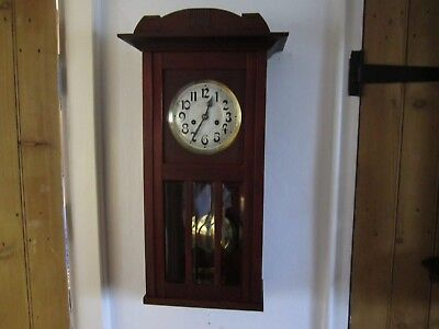 Antique Art Deco Chiming Mahogany Wall Clock In Very Good Working Order.