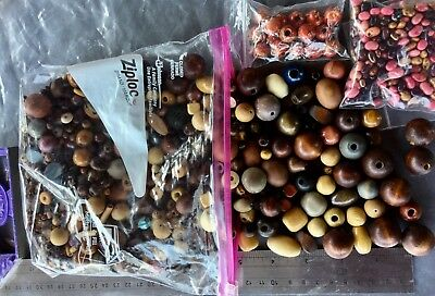 Lot of 1.2lbs mixed Craft Wooden Beads w/many sizes and shapes.