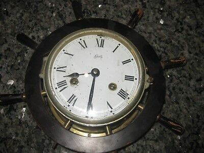Vintage Schatz ships bell clock in ships wheel, working , with key