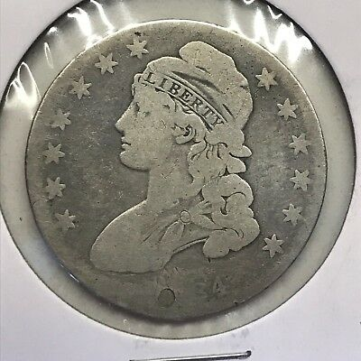 1834 50C Capped Bust Half Dollar: Holed & Plugged