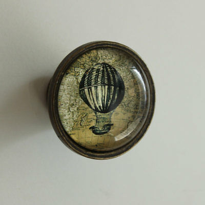 Vintage rustic style brass metal drawer pull with hot air ballon and glass front