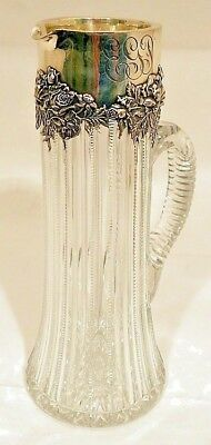A huge sterling/glass pitcher, floral decoration. Dominick & Haff, New York