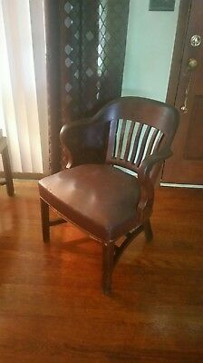 Antique barrel back leather Courthouse chair