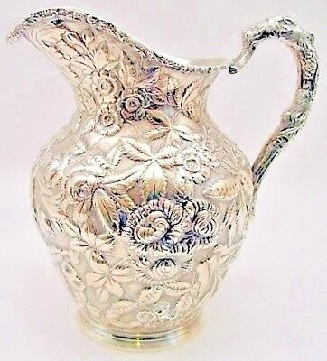 An early sterling repousse water pitcher, Stieff c.1900.