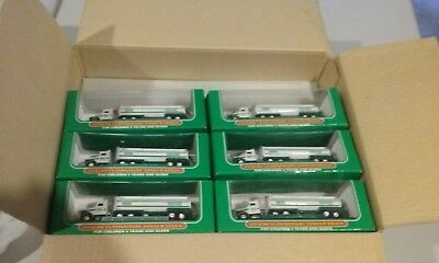 OPEN CASES of NOS 1998/1999 HESS Trucks (Miniature Tanker and Fire Trucks)