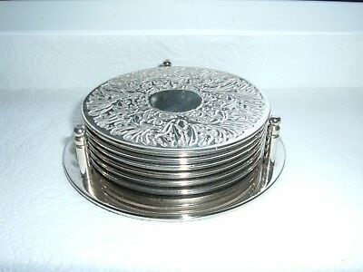 6 Silver Plated Coasters and Stand