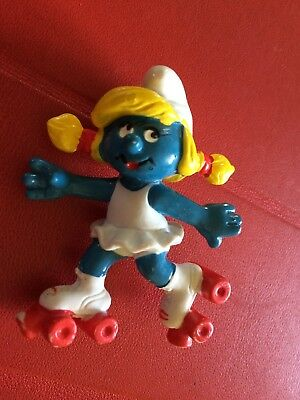 VINTAGE SMURFETTE ROLLING SKATE shipping is for up to 10 smurfs