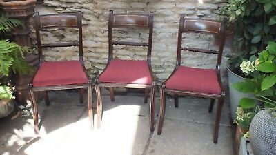 A set of 8 matched  Regency mahogany rope back dining chairs