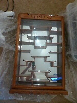 Glass hinged fronted, mirrored display cabinet, ornaments collectables oriental