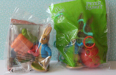 2x Spielzeuge Peter Rabbit Launcher & Light Maze HAPPY MEAL ENGLAND NEU & OVP
