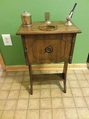 Smokers table made of wood, has pipe holders, ashtray, extra items included