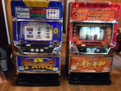 2 slot machines take tokens included Lights Sounds  working condition