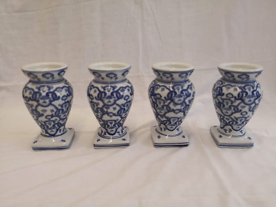 Set of four Blue  and White candle stands