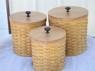 3 Longaberger Basket Canisters With Wood Lids and sealed protectors