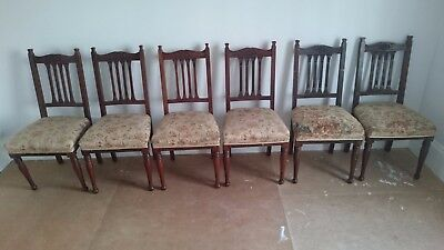 Set of 6 antique upholstered mahogany dining chairs with carved details