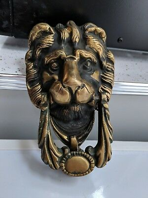 Vintage Brass Lion Head Door Knocker Black Background with Screws