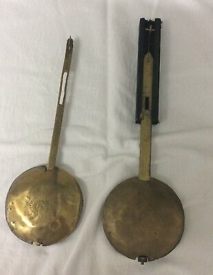 Two Fusee Clock Pendulums