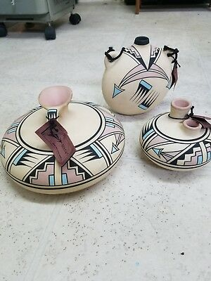 Lot of 3 Beautiful Handpainted Indian Arrow Pottery signed and numbered .