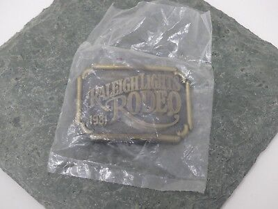 NIP Raleigh Lights Rodeo Belt Buckle 1981 RJ Roberts Vintage