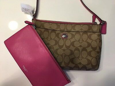 Coach..Peyton Signature Swingpack With Pop Up Pouch.. Khaki/Fuchsia..NWT
