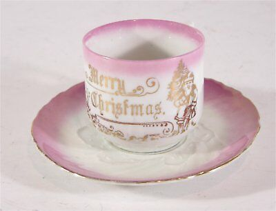 SANTA CLAUS BELSNICK CHRISTMAS SOUVENIR CHINA CUP AND SAUCER w/ GILT DECORATION