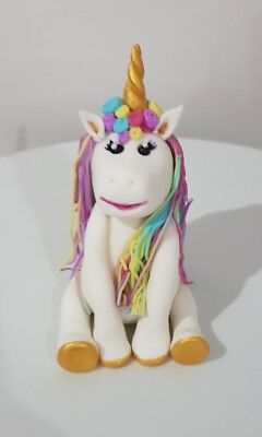 Edible  hand made unicorn cake topper for birthday  occasion