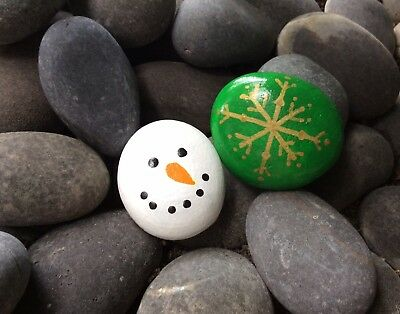 set of 2 festive hand painted rocks snowman and snowflake christmas design