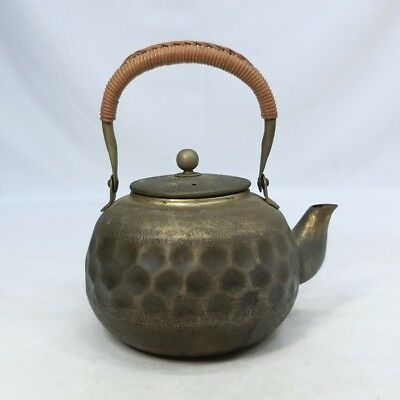 G509: Japanese kettle for tea ceremony of brass with popular dent style.