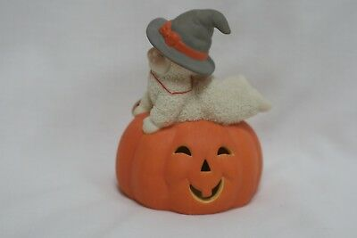 Snowbaby laying on a flat Jack-o-latern Dept 56