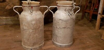 Pair of Original Vintage Aluminium French Milk Churn with lids on chain