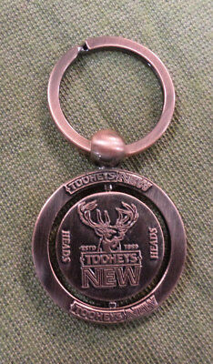 #D324. TOOHEYS NEW BEER KEYRING - SPINNING CENTRE, HEADS or TAILS