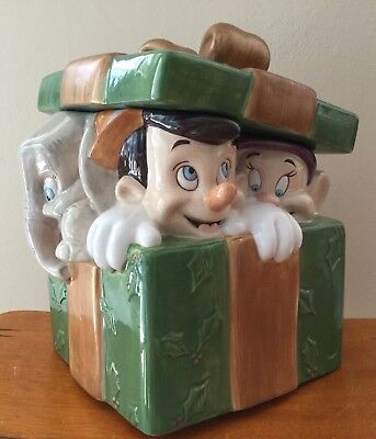 Pinocchio, Dumbo, Dopey and Mickey wrapped in a Christmas present box