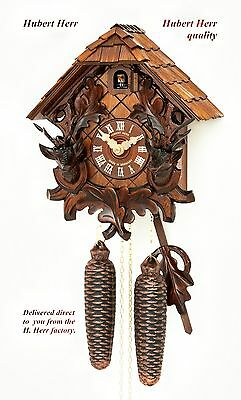 Hubert Herr,  lovely new 8 Day cuckoo clock with 2 hand carved stags heads.