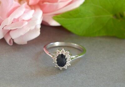 Vintage style rhodium plated sterling silver ring with dark blue & clear stones