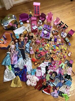 Huge Lot of Barbie Dolls &ClothingFurniture & Accessories 243 Pieces