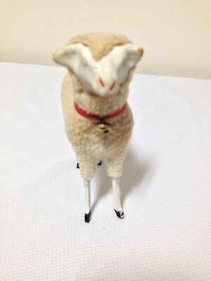 Vintage sheep-head is ceramic, legs are wood,covered in fabric