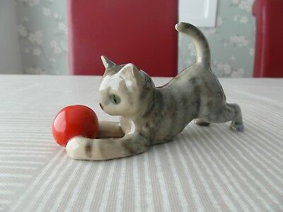 German Porcelain Tabby Cat Playing With Red Ball