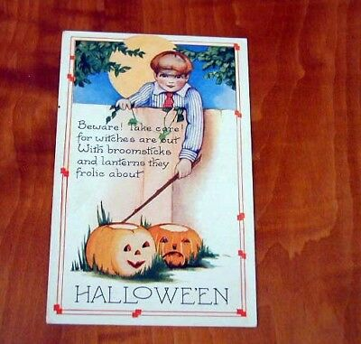 1906 HALLOWEEN EMBOSSED POST CARD BY WHITNEY BOY AT FENCE w/ STICK + J-O-L MINT