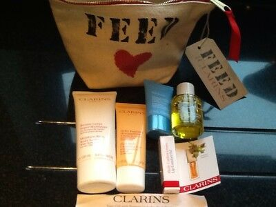 Clarins Feed 10 Makeup Bag Incl Body Lotion Cleanse Gel Face Mask & Lip Oil New