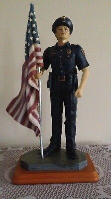 Ceramic Police Figurine with US Flag collectible