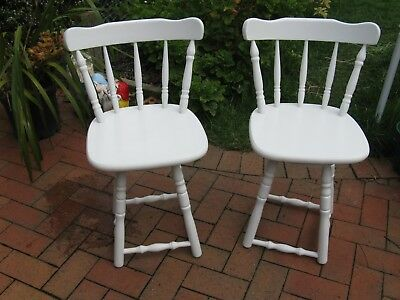 Pair Of White Painted Swivel Wooden Chairs .