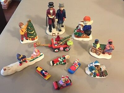 11 Pc.  Various Holiday -Christmas village figurines ice skating, sled, wagons